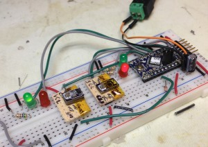 The hall effect sensor board passes (green light) while the unused accelerometer tester fails (red light).