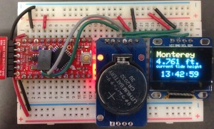 The three components of my simple tide clock from left to right: Arduino Pro Mini 3.3V (red), Real Time Clock (blue), SSD1306 OLED display.