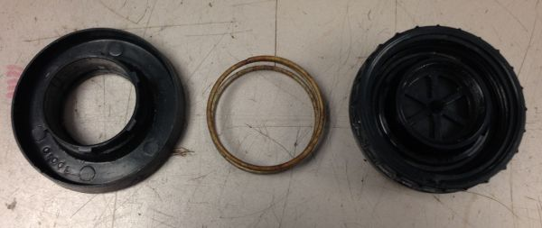 The successfully separated valve body, spring, and protector ring (base plate).